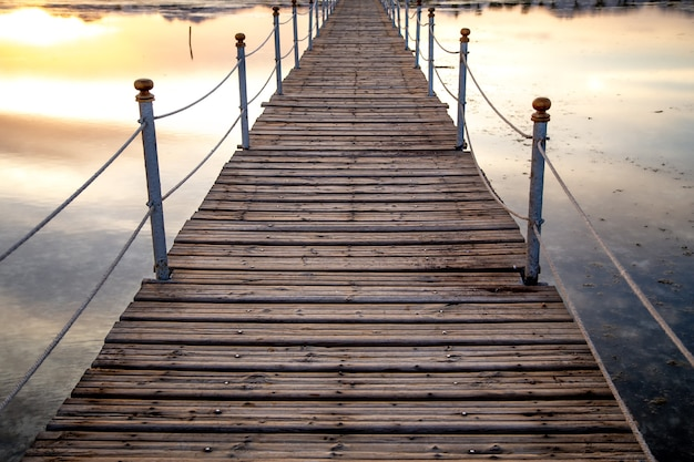 Beautiful long wooden pier close up.