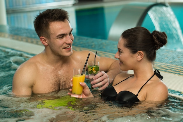 Beautiful loving couple relaxing in a jacuzzi tub together