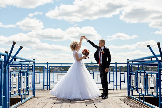 Beautiful loving wedding couple registers a marriage and walks along the beautiful promenade