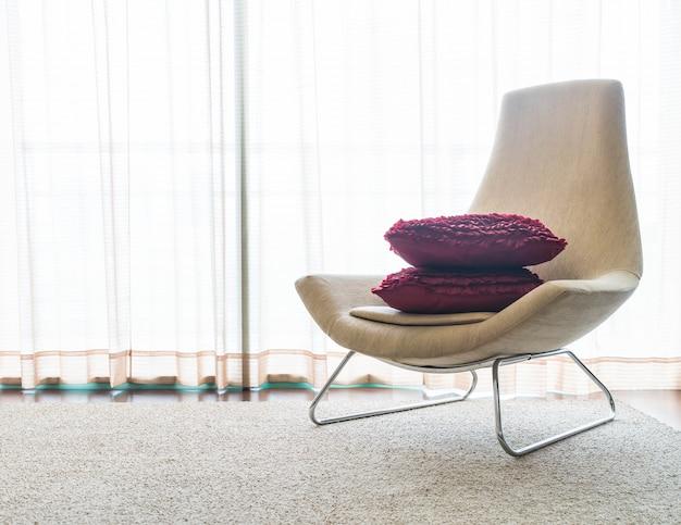 Bello cuscino di lusso sul divano decorazione in salotto interni per lo sfondo