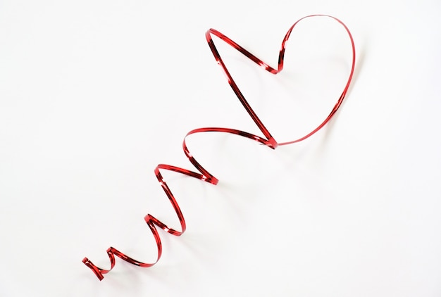 Beautiful luxury red heart shape from wire ribbon on white background use for valentines day