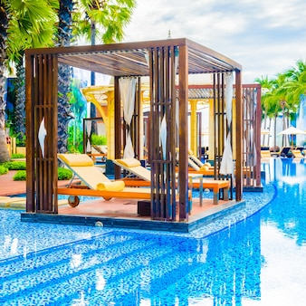 Beautiful luxury swimming pool with outdoor deck in hotel resort