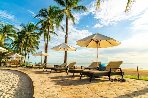Beautiful luxury umbrella and chair around outdoor swimming pool in hotel and resort