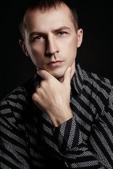 Beautiful male portrait on black