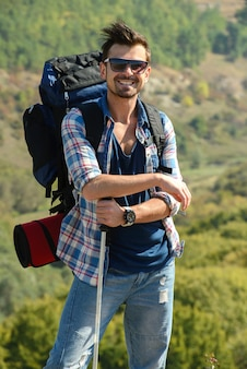 Beautiful man hiking outdoors leading a healthy lifestyle.