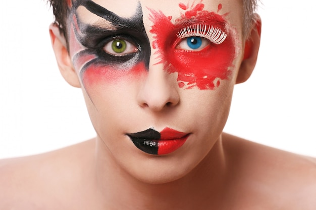 Beautiful man with abstract make up on white