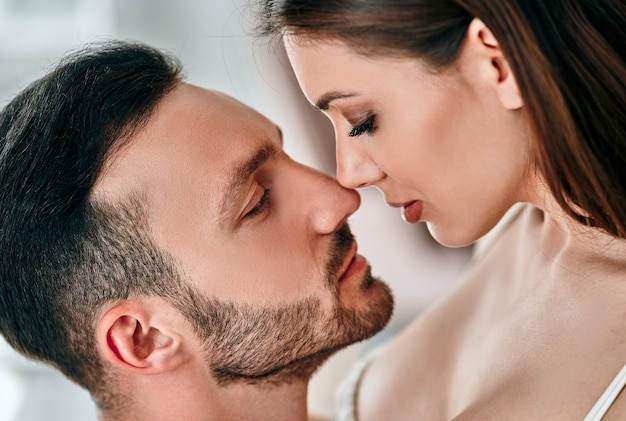 The beautiful man and woman kissing