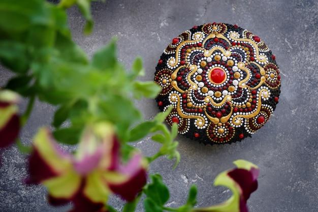 Beautiful mandala rock on concrete background