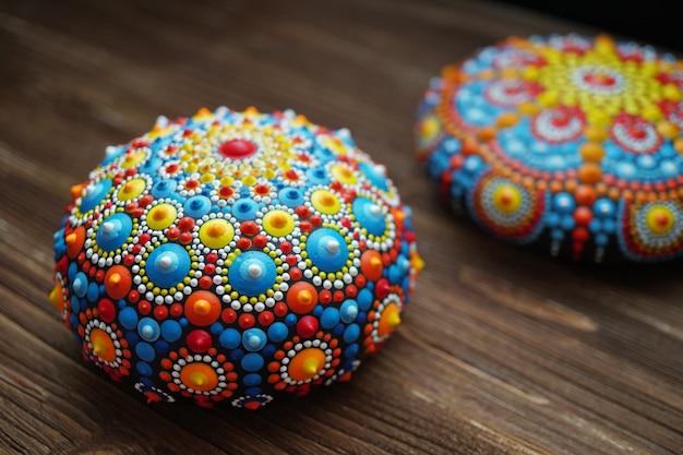 Beautiful mandala rocks on wood background