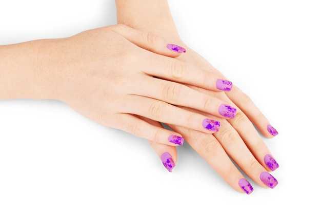 Beautiful manicure, nail gel with foil in matt top on a white background