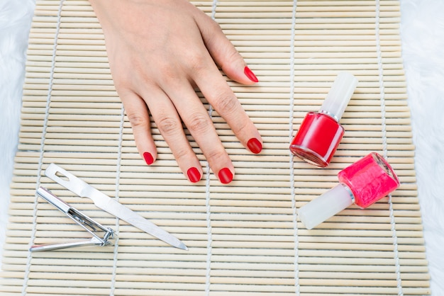 Beautiful manicured woman's nails with red nail polish