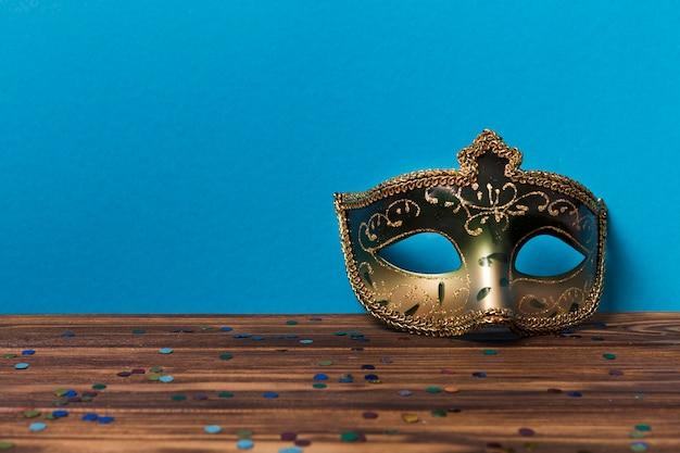 Beautiful mask near blue wall
