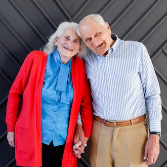 Beautiful mature man and woman posing