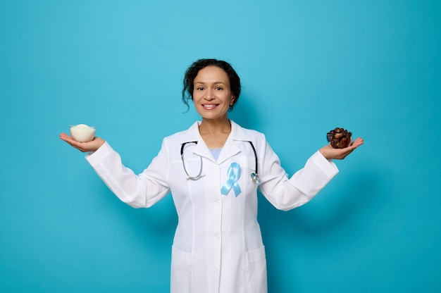 Beautiful mature smiling female nutritionist holding a bowl with refined white sugar in one hand and ripe sweet dates in the other. sugar and diabetes concepts for diabetic day at 14 november