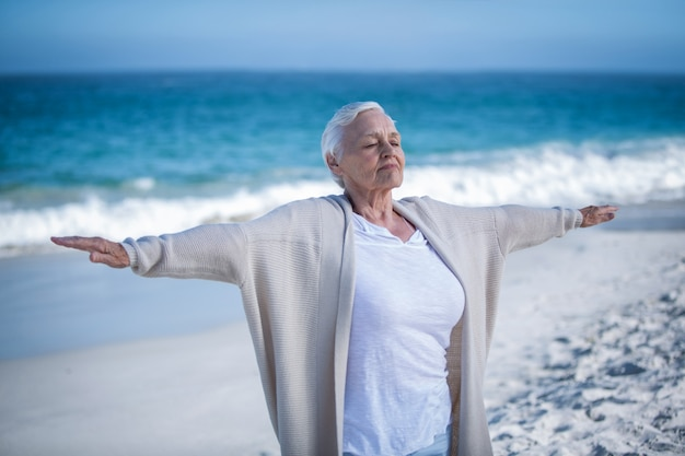 Beautiful mature woman outstretching arms