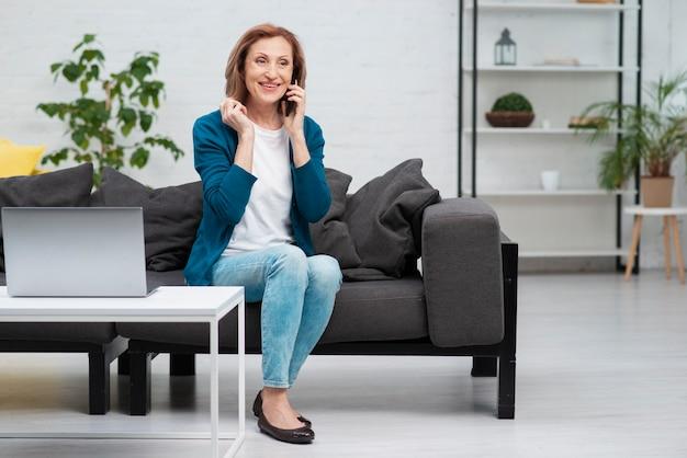 Beautiful mature woman talking on the phone