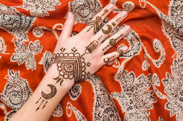 Beautiful mehndi paints on woman hand