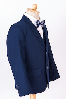 Beautiful men's blue jacket suit with shirt and bow tie on white background