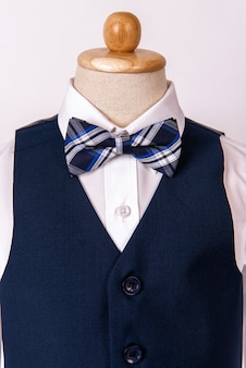 Beautiful men's blue suit with shirt and blue bow tie
