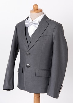 Beautiful men's grey jacket suit with shirt and bow tie on white background.