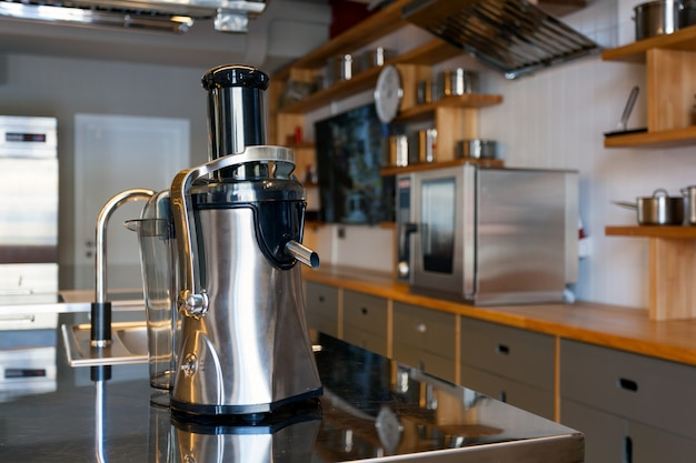A beautiful metal juicer stands in modern kitchen