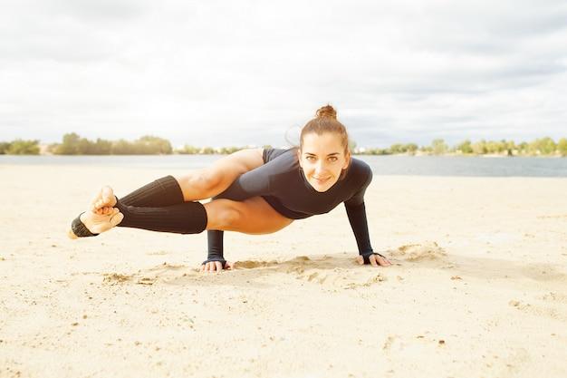 Beautiful middle-aged girl doing yoga exercises
