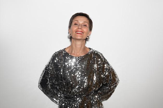 Beautiful middle aged woman wearing a shiny dress