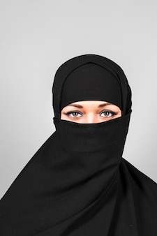 Beautiful middle eastern woman in niqab traditional veil.