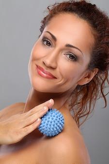 Beautiful middleaged woman massages herself