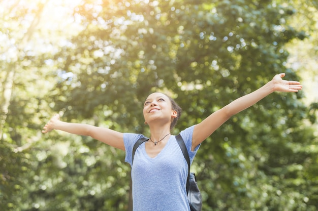 Beautiful mixed-race young woman at park, sense of freedom
