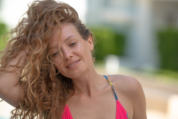 Beautiful model girl with long curly blond hair.