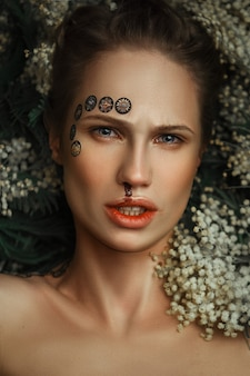 Beautiful model is deeply emotionally posing in a dark studio