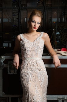 Beautiful model in lace fitted dress posing