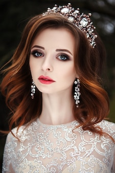 Beautiful model wearing glamourous dress and crown