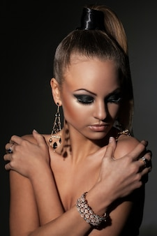 Beautiful model with ponytail and makeup