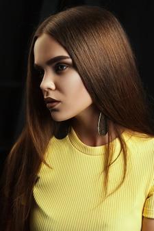 Beautiful model in a yellow dress