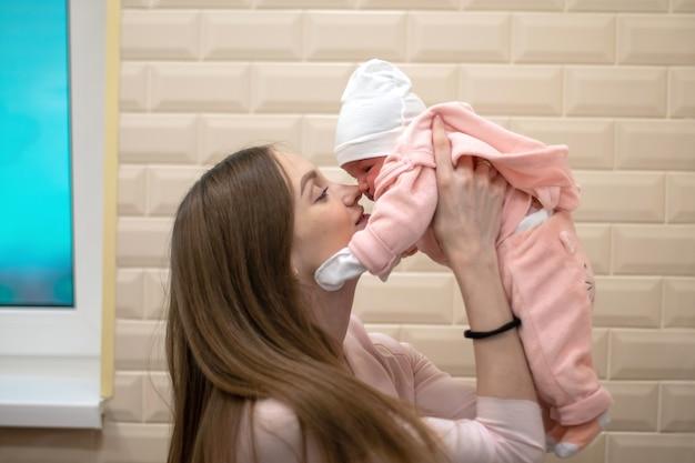 Beautiful mom with little newborn daughter