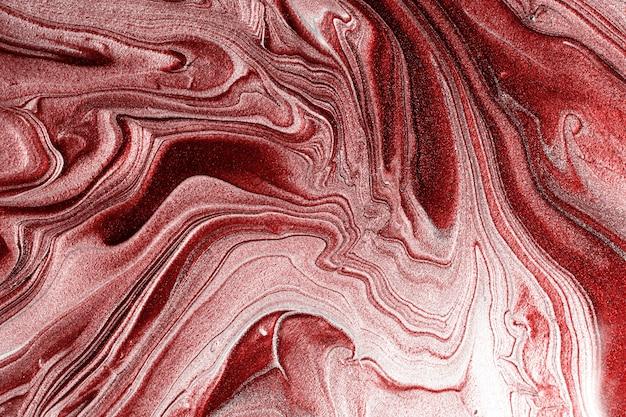 Красивые монохромные мерцающие пятна жидкого лака для ногтей. полосатая текстура краски. фон потока лака для ногтей в технике флюид-арта. концепция минимализма. копирование пространства, горизонтальная фотография.