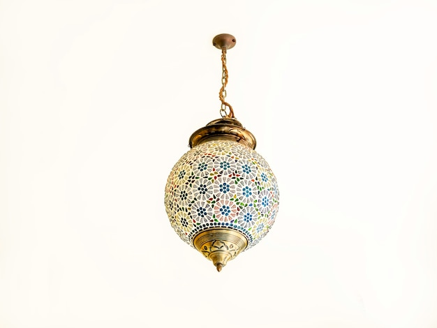Beautiful moroccan style light lamp, hanging lantern on the white ceiling.