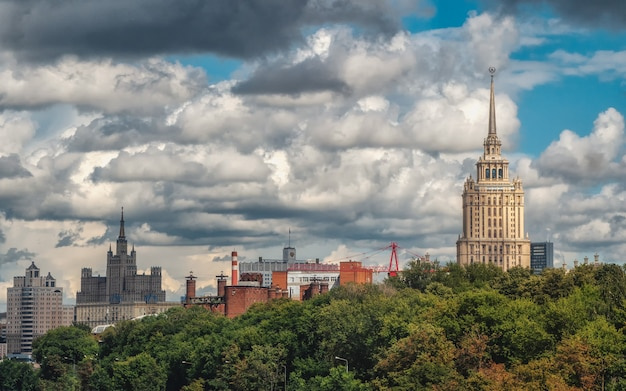 Beautiful moscow cityscape. panoramic view of moscow with beautiful houses on a green hill.