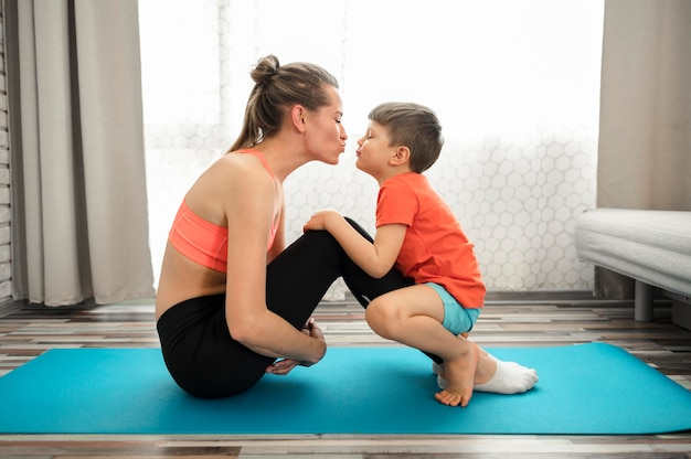 Beautiful mother exercising with son