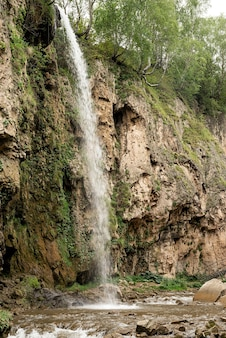 Beautiful mountain waterfall on rainy day