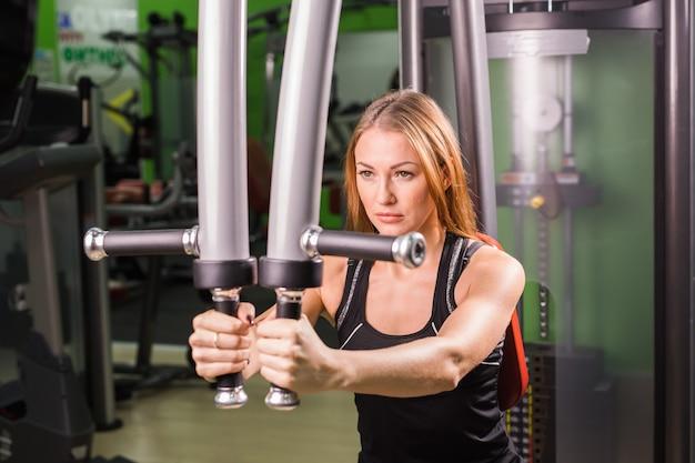 Beautiful muscular fit woman exercising