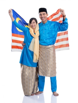 Beautiful muslim couple with malaysian flag