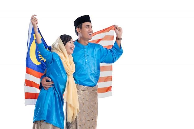 Beautiful muslim couple with malaysian flag