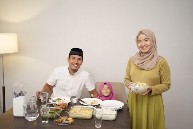 Beautiful muslim family having dinner together