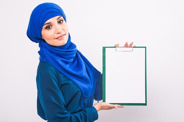 Beautiful muslim fashion girl holding an empty banner, copy-space.