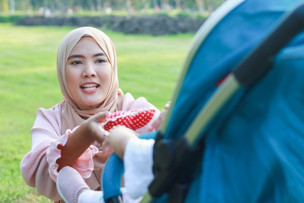 Beautiful muslim girl holds a red heart with