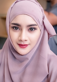 The beautiful muslim woman looking straight with twinkling eyes,smart lady