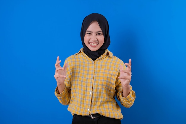 Beautiful muslim woman using gesturing her hands and seriously expression d